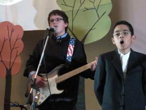 Daniel, leading the children in song.